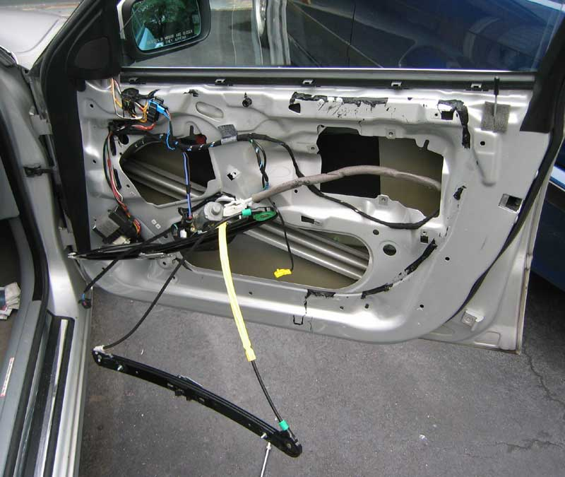 Photo of disassembled door, showing window mechanism